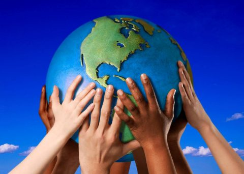 Multicultural hands supporting the globe